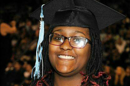 Alumna Lopacious Simms smiles after graduating in 2015. Simms is currently studying criminal justice at Southeast Missouri State University.