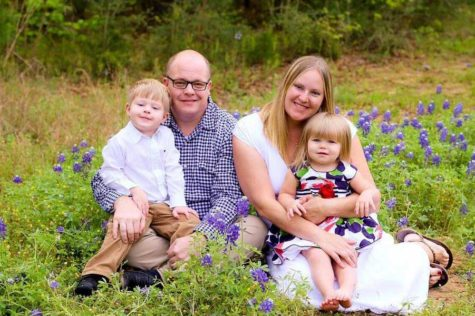 Latin teacher Jodi Wickman poses with her husband and her two children, Edmund and Cosette.