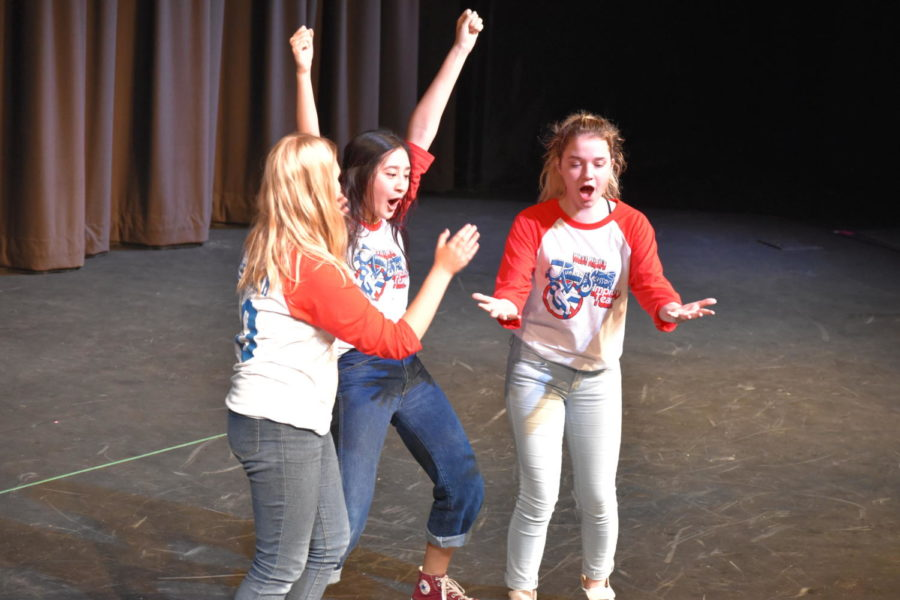 Paulina Taranda, Maddie Cooke and Sophie Marx do an improv skit about veganism and explosions.