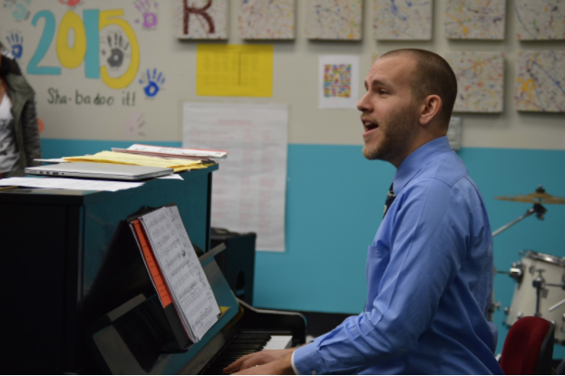 """Music teacher Brian Parrish instructs the concert choir on facial expressions. Parrish has been singing since his childhood. """"Voice is my primary instrument, always has been, but I'm also a jazz pianist—I can manage my way around that pretty well,"""" Parrish said."""