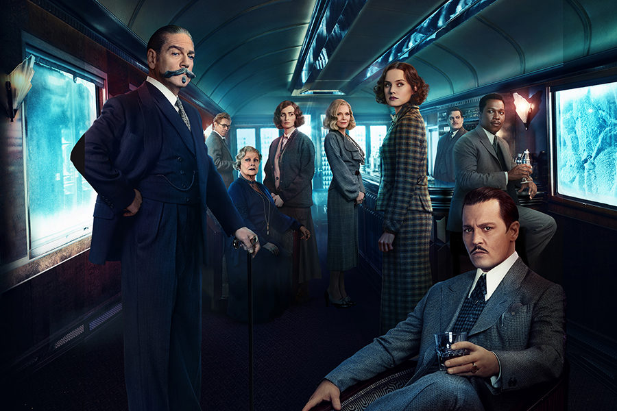 Detective+Hercule+Poirot%2C+alongside+other+passengers+on+the+Orient+Express%2C+poses+in+the+dining+car+for+a+promotional+image.