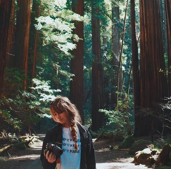 "Posing with her camera, sophomore Caroline Judd explores the Redwoods. Caroline vacationed in California over spring break and, inspired by Instagrammer @zoelaz, took many photos and shared them on her personal Instagram, @cjuddc. ""I love lifestyle photos and I also really like National Geographic because you see parts of the world that you didn't even know existed,"" Caroline said."