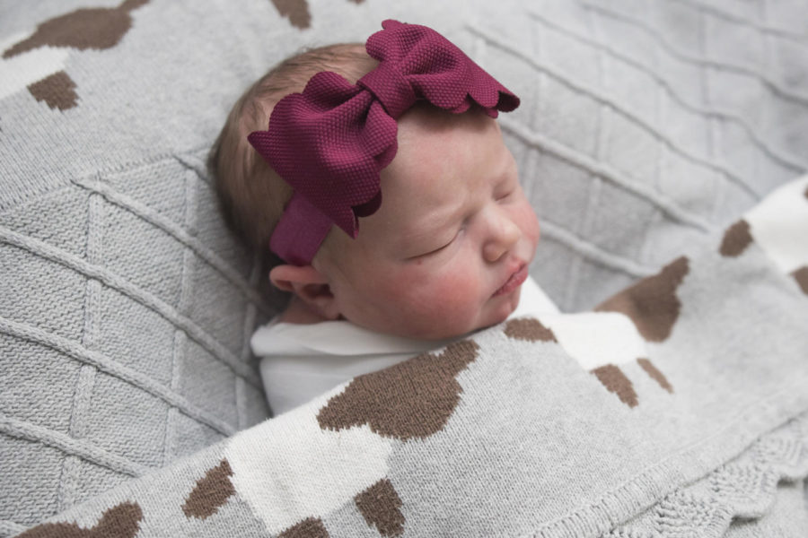 """While at the hospital, Margot Barnes snuggles under a warm blanket. Margot is the second child of English teacher Dan Barnes and wife Julie Barnes. """"My first thought was just awe. Totally awestruck,"""" D. Barnes said."""