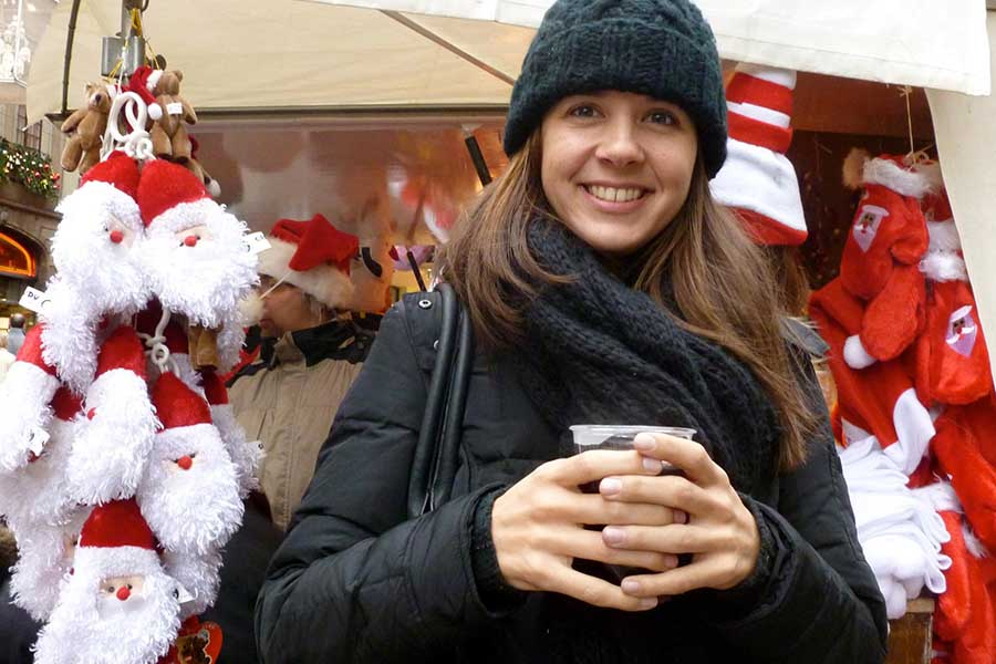 Hopkins poses by the Christmas market in Strasbourg, France.