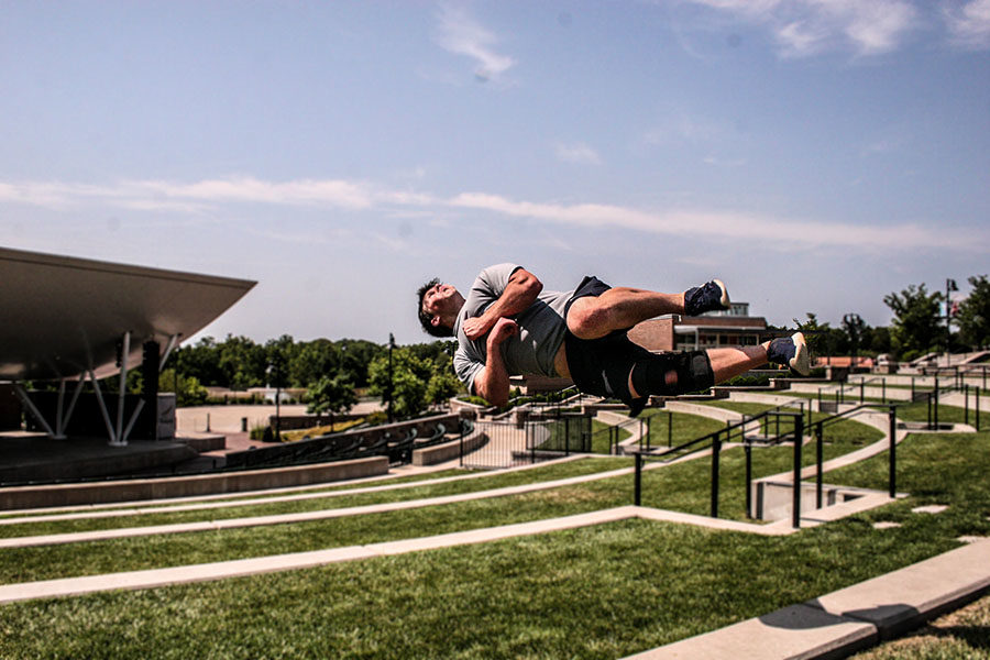 Senior+Joe+Roseman+flips+off+a+ledge+at+the+Chesterfield+Amphitheater+for+one+of+his+training+films.+Roseman+has+been+practicing+parkour+for+six+years.+%22It%E2%80%99s+still+a+really+big+stress+reliever+for+me%2C%E2%80%9D+Roseman+said.+%E2%80%9CWhenever+I+train%2C+it+just+feels+so+natural.%22