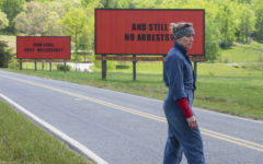 Mildred Hayes stands in front of two of her billboards alongside a road outside Ebbing, Missouri.