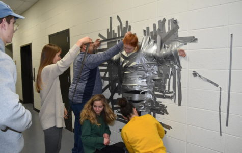"In eight minutes, the Pathfinder editorial board and building manager Scott Bollmann duct taped arts and entertainment editor junior Nell Jaskowiak to the wall for a test run of the ""Duct Tape Your Teacher to the Wall"" fundraiser that will be next Friday, Jan. 26. The money raised from this fundraiser will go to their trip to New York to accept the Columbia Scholastic Press Association Crown Award, which is one of the highest awards in high school journalism. ""It was pretty cool to know that basically just [the duct tape] on my arms and legs was holding me to a wall in the school basement,"" Jaskowiak said. ""We've made a thriving website and got Best of Sno last year and hopefully this year again. Now were one of the top 19 schools in the nation, which is insane, so we'd like to be able to go receive [the Crown Award]."""