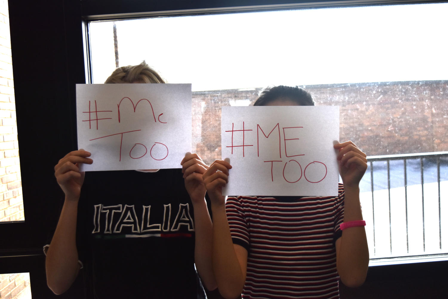 Holding signs stating, '#MeToo', students express support for the movement encompassing the media.