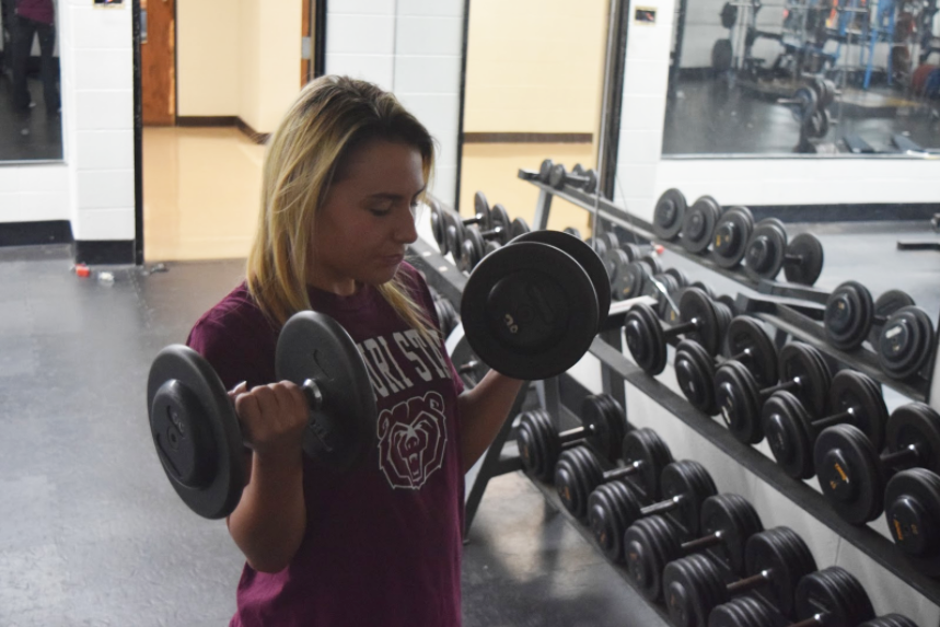As+part+of+her+workout+routine%2C+senior+Maddi+Grant+lifts+15-pound+dumbbells.+Grant+started+weightlifting+to+build+more+muscle+and+challenge+herself.+%E2%80%9CI+learned+from+a+personal+trainer+that+you+should+not+focus+on+just+one+muscle+group+a+day%2C+otherwise+other+parts+of+your+body+get+weaker.+I+do+ab+exercises%2C+arms+and+legs+on+a+day+to+day+basis+just+to+change+it+up%2C%E2%80%9D+Grant+said.+