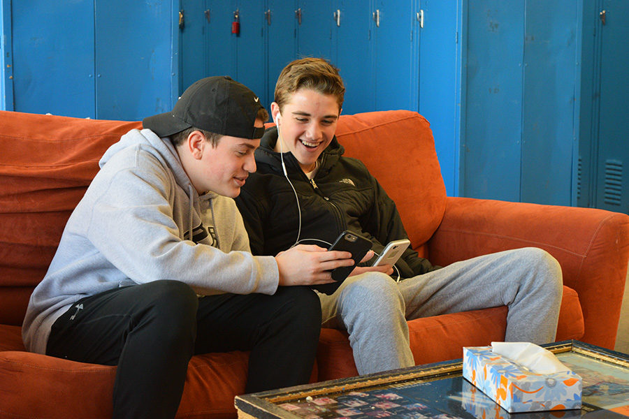 """Freshmen Jackson Gorman and Thomas Anderson play HQ together during their study hall for the 2 p.m. game. """"I really like to play the game but I haven't won any money yet,"""" Thomas Anderson said. """"It is really addicting to play, which makes it hard to not play during study hall."""""""