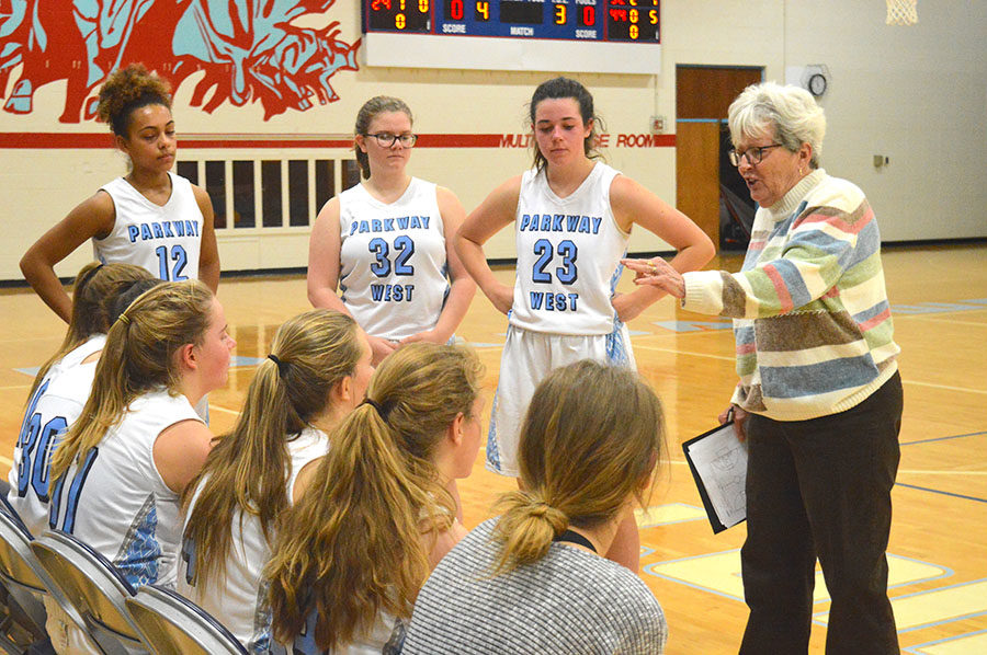 Freshmen+basketball+coach+Peg+Schane+provides+feedback+to+her+players+during+halftime+against+St.+Dominic%2C+Jan.+10.+The+freshmen+basketball+team+has+a+record+of+10-0-0.+%E2%80%9CI+feel+like+coach+Schane+has+helped+us+a+lot+to+be+undefeated+at+this+point+in+the+season%2C%E2%80%9D+freshmen+girls+basketball+team+captain+Leah+Selm+said.