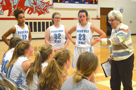 Freshman girls basketball coach Peg Schane leads players in an undefeated season