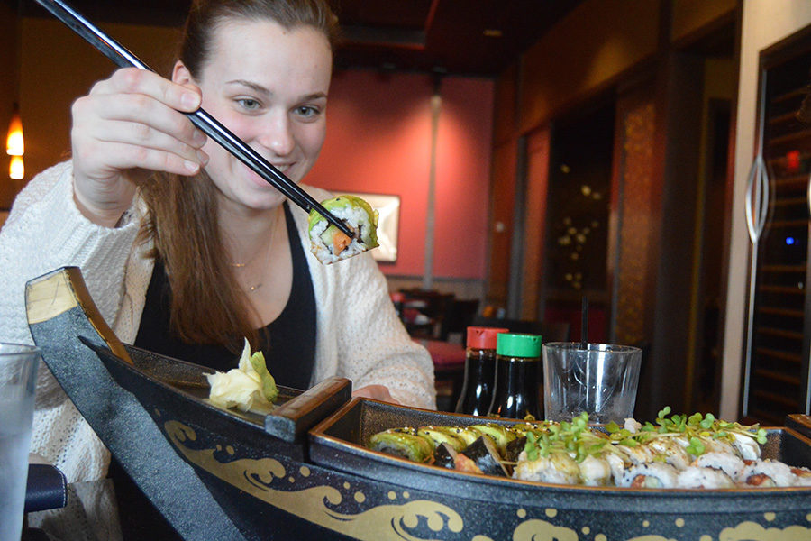 """Staff writer Maria Newton enjoys sushi at Wasabi Sushi Bar. Wasabi's menu features options from California Rolls to Teriyaki Chicken and has been voted St. Louis's best sushi by Sauce Magazine for the past 13 years. """"I had no problem finishing off four sushi rolls with just a couple friends to help,"""" Newton said."""