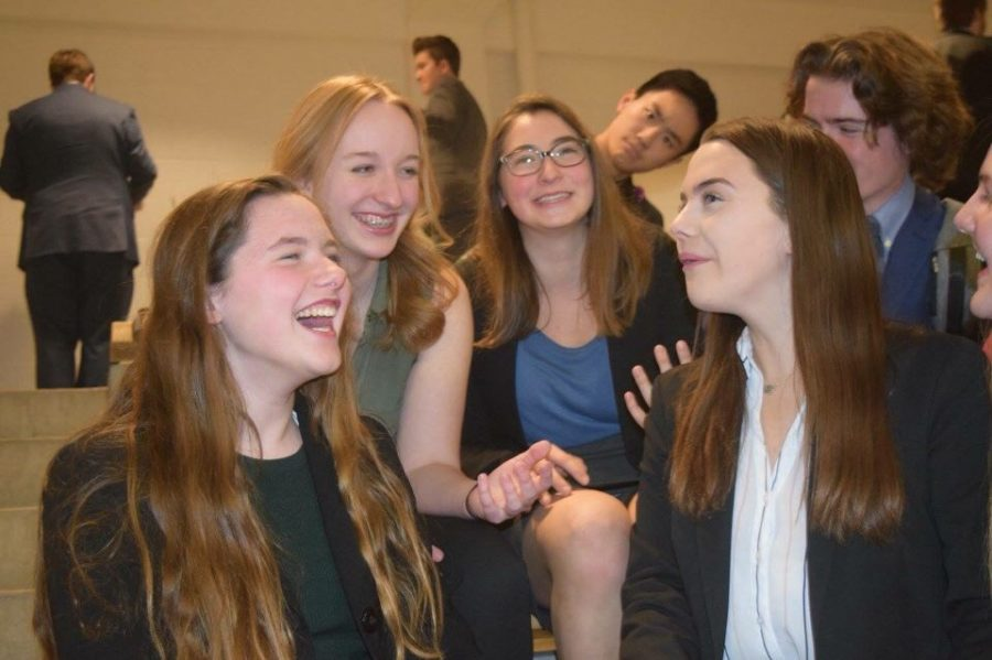 """Freshmen Zoey Womick, Laura Young, Ella Siegel and Grace O'Connor laugh at the Jefferson City Capital Classic. The debate tournament was held on Jan. 26 and Jan. 27 as one of the last tournaments before districts. """"My favorite memory was staying at the hotel with the team and bonding with everyone,"""" O'Connor said."""