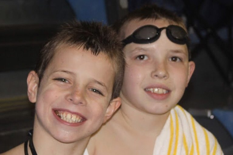 "2016 graduate Drew Bonnett and the late Joe Ross pose for a picture at a Parkway Swim Club swim meet. Bonnett and Ross swam together for many years and grew up as best friends. ""Joe was a light of joy and laughter,"" Bonnett said. ""I loved him and respected him deeply."""