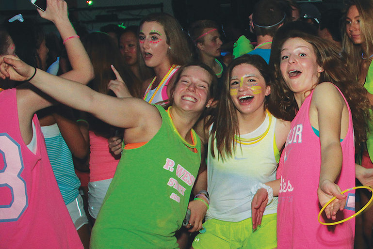 Seniors+Jessica+Schlueter%2C+Sam+Walkoff+and+Maggie+Newberry+dance+and+enjoy+the+glow+dance+that+was+held+last+year.+%E2%80%9CI+think+glow+dance+is+more+fun+because+it%E2%80%99s+not+a+formal%2C%E2%80%9D+Newberry+said.+%E2%80%9CAround+this+time+in+the+year+I+don%E2%80%99t+want+to+go+to+another+formal+because+we+already+have+so+many%2C+especially+with+prom+for+the+upperclassmen%2C+and+it%E2%80%99s+a+great+opportunity+to+let+loose.%E2%80%9D