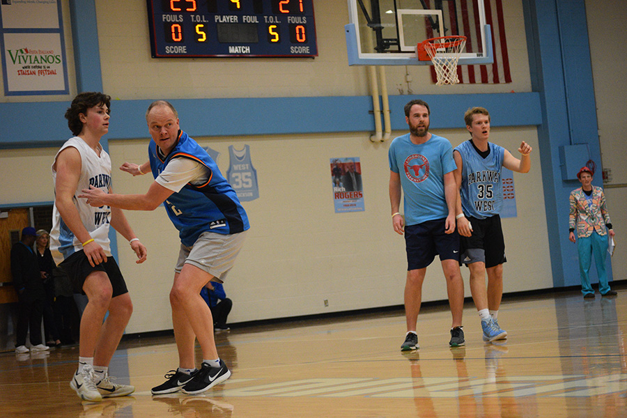 Principal+Jeremy+Mitchell+guards+senior+Jack+Swiney+from+getting+the+ball.+Over+one+thousand+dollars+in+proceeds+from+the+game+was+raised+for+Friends+of+Kids+with+Cancer.+%E2%80%9CThis+year%2C+I+made+one+basket+which+was+more+than+last+year%2C%E2%80%9D+Mitchell+said.+%E2%80%9CI+enjoy+playing+basketball+and+helping+to+raise+money+for+a+good+cause.+It+was+nice+to+look+up+%5Bto+the+crowd%5D+and+seeing+all+the+students+in+attendance.%E2%80%9D%0A%0A