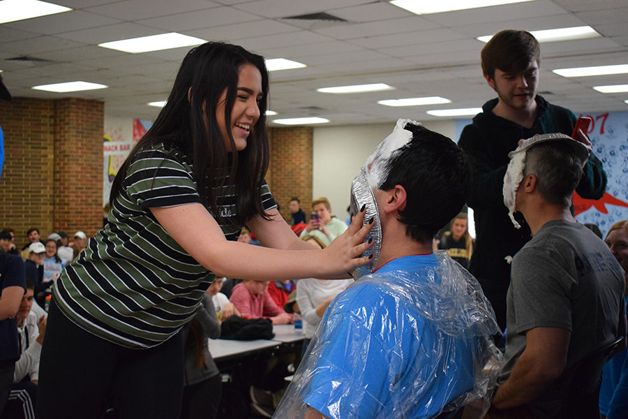 "Smashing a pie into Assistant Principal Mario Pupillo's face, sophomore Hillary Herrera celebrates Pie Day with her classmates. Each year Key Club holds a Cash for Cancer fundraiser for Friends of Kids With Cancer. ""When they called my name to pie Mr. Pupillo in the face my heart stopped,"" Herrera said. ""All my friends were cheering for me, and he gave me a high-five afterwards. It's such a crazy and bizarre thing to do, so I'm really happy I got to pie my principal in the face."""