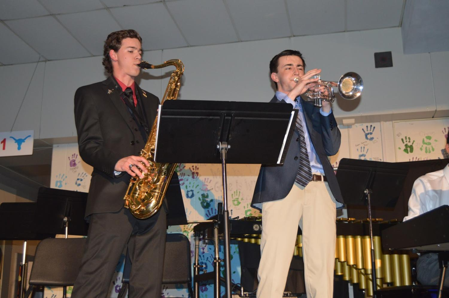 """Senior Jonah Hathaway and junior Noah Wright perform at the Jazz Coffee House concert. Both students are members of the jazz band led by band director Brad Wallace and choir director Brian Parrish. """"Jazz was a genre of music that I wasn't familiar with,"""" Wright said. """"Being in Jazz Band has made me a better musician and has helped me to enjoy music even more."""""""