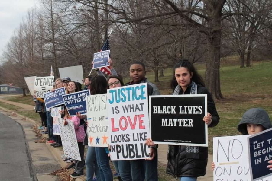 Rallying+across+the+street+from+the+Parkway+School+Board+Candidate+Forum+at+the+Islamic+Foundation+of+Greater+St.+Louis%2C+Parkway+students%2C+parents+and+alumni+share+signs+that+address+white+supremacy+on+the+Board+of+Education.+Students+also+protested+and+talked+to+voters+at+polling+sites+April+3+to+help+spread+their+message.+%E2%80%9CAt+about+eight+different+locations%2C+%5Bstudents%5D+protested+basically+all+day%2C+holding+up+signs%2C+talking+to+voters+and+making+sure+that+they+knew+to+make+an+informed+decision%2C%E2%80%9D+senior+Cheryl+Ma+said.