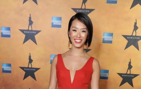 "Alumna Yvette Lu stands on the red carpet at the camera at Opening Night for Hamilton. Celebrities like Paris Hilton and Jimmy Kimmel were also in attendance along with various hairdressers, designers, actors and dancers. ""There was a lot of excitement from that evening, largely because a lot of celebrities came to Opening Night,"" Lu said. ""Lin-Manuel Miranda was also there, which was exciting."""