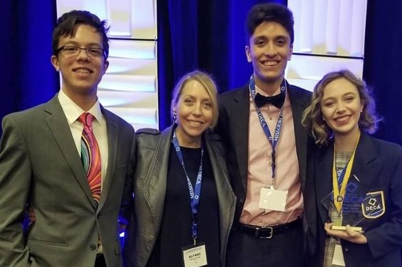 """Juniors Tony Galanti, DECA Sponsor Holly Weber, Caleb Canatoy and Kristin Priest finish competing at the State DECA competition in Kansas City. Weber helped Priest prepare for each of her competitions through online practice. """"I hope that I medal, but just the fact that I'm qualified is pretty awesome,"""" Priest said. """"So, whatever I do I'm glad that I'll be there. I will be there for six days by myself, so it will be a good learning experience."""""""