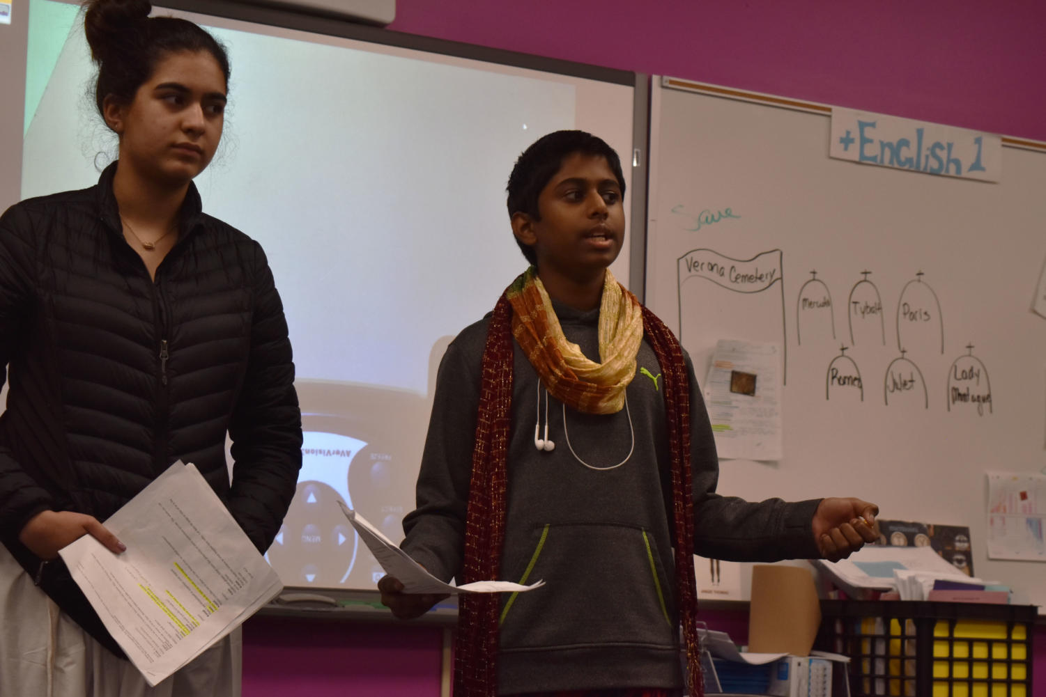 Explaining+the+historical+context+of+their+group%E2%80%99s+colonial+India-themed+script%2C+freshmen+Fatema+Rehmani+and+Sri+Jaladi+speak+to+their+Honors+English+1+classmates.+Students+researched+topics+including+historical+events%2C+clothing%2C+housing%2C+culture+and+the+daily+life+of+people+from+their+assigned+era.+%E2%80%9CIt+was+challenging+and+definitely+required+us+to+push+ourselves%2C%E2%80%9D+Jaladi+said.+%E2%80%9CIt+was+a+great+experience+learning+how+to+not+procrastinate+and+stay+organized.%E2%80%9D%0C