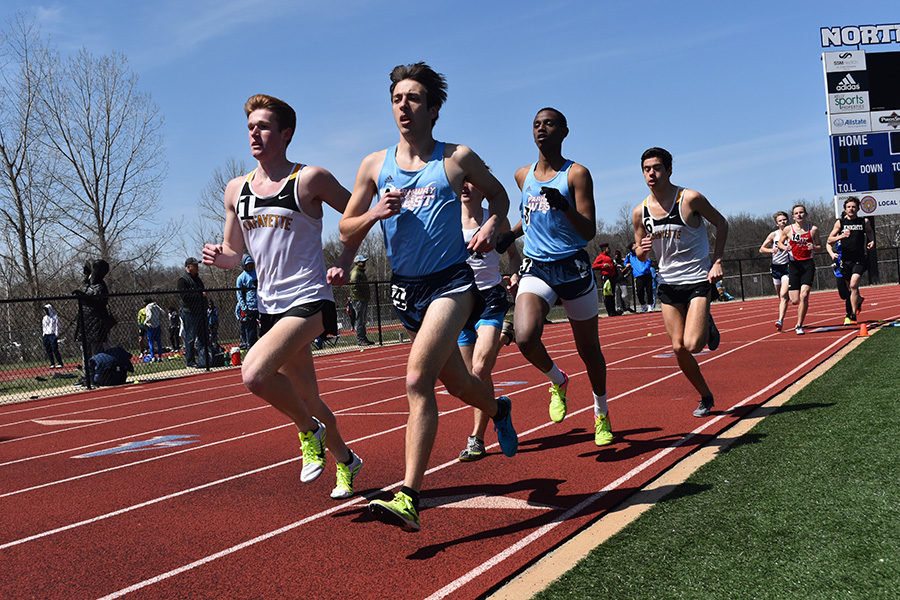 """Pulling ahead of the crowd, senior Matyas Csiki-Fejer competes in the 1,500 meter race at the 5th Annual Northwest Invitational Track Meet. Senior Cerow Aligab came in third at 4:19.07, and Csiki-Fejer placed fourth at 4:19.83. """"I'd like it if we qualified for state in the 4x8, and individually, in the 800 [meters] and the mile. I'm working towards these goals by just going to practice everyday,"""" Csiki-Fejer said. """"Give it your all. Focus on the hard workouts. Nothing else matters when you're racing."""""""