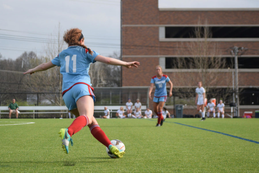 Junior Bella Hatzigeorgiou glides into a pass. The game against Nerinx Hall took place on the opposing team's home turf.
