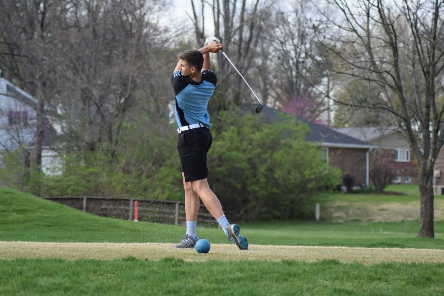 """Swinging his club, senior Jack Gieseking sends the golf ball flying down the range in a match against Rockwood Summit. Gieseking, as well as seniors Kyle Anderson and Andrew Sherrill, junior Will Bias and sophomore Johnny Yazdi qualified for districts April 30. """"One goal for the rest season is to qualify for sectionals,"""" Gieseking said. """"You have to shoot decently low at districts to qualify for sectionals, and it all depends on how the field is doing, but but our top guys moving on to districts are doing really well right now, so we're hopeful."""""""