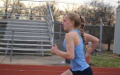 """Tess Allgeyer runs down the track as she gets back into the program. Fighting through her injury, Allgeyer hopes to return. """"I should be able to come back and compete with the team, and I will be able to run track next year,"""" Allgeyer said."""