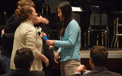 "With a trophy in hand, speech and debate coach Cara Borgsmiller congratulates senior Cheryl Ma. She alongside fellow senior Ryan O'Connor qualified for the 2018 National Speech & Debate Tournament in public forum debate after going undefeated at the Eastern Missouri district tournament. ""It was really exciting. It was different than it is for most people because Ryan and I were undefeated the whole tournament, so they decided [we qualified] automatically even before the actual awards were announced since we were the only undefeated team,"" Ma said. ""We found out before the actual awards ceremony, so it relieved a lot of pressure because usually people are very anxious during awards."""