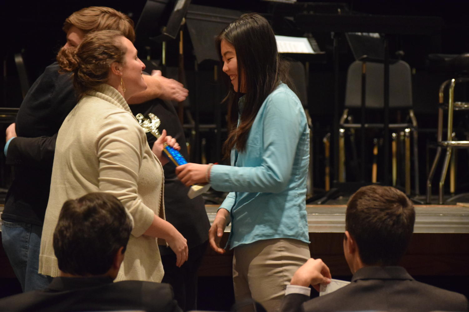 """With a trophy in hand, speech and debate coach Cara Borgsmiller congratulates senior Cheryl Ma. She alongside fellow senior Ryan O'Connor qualified for the 2018 National Speech & Debate Tournament in public forum debate after going undefeated at the Eastern Missouri district tournament. """"It was really exciting. It was different than it is for most people because Ryan and I were undefeated the whole tournament, so they decided [we qualified] automatically even before the actual awards were announced since we were the only undefeated team,"""" Ma said. """"We found out before the actual awards ceremony, so it relieved a lot of pressure because usually people are very anxious during awards."""""""