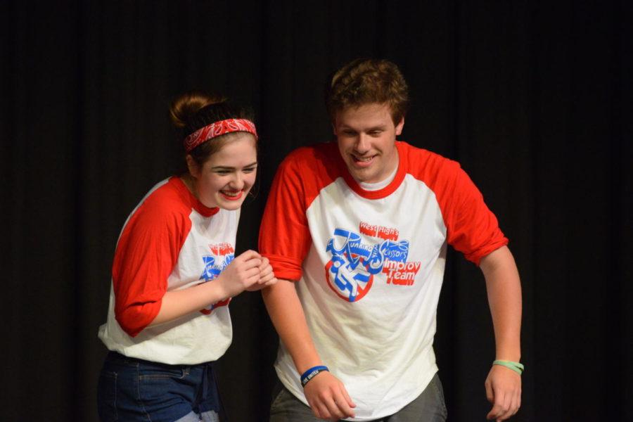 Freshman Clare Weaver and junior Derek Isele perform an improv scene.