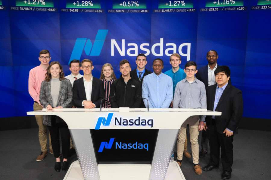 """Vivid+ students take group picture at Nasdaq while visiting New York. Not only did they go to Nasdaq, but they also visited Facebook to get experience in the real world. """"We learned so much by talking to mentors about moving on into college and how to diversify yourself and make yourself stand out when your getting a job or an internship,"""" junior Cameron Sato said."""