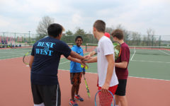"""Huddling up, members of the boys tennis team prepare to practice. """"On and off the court, tennis taught me how to persist, find my voice, and forge relationships,"""" senior and captain Chris Nariskin said."""
