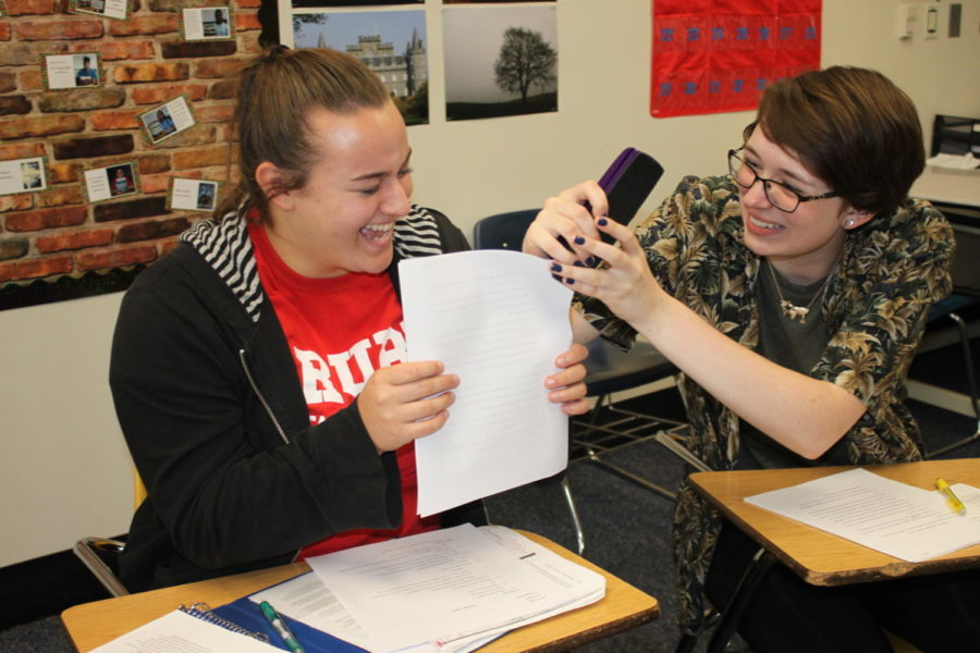 "Seniors Erin Puhan and Ann Truka attempt to staple an essay in their AP English Literature and Composition (AP Lit) class. AP Lit is the senior honors option English course. ""I think English is very collaborative,"" AP Lit teacher Andria Benmuvhar said. ""You read together, you talk together, and, apparently, you staple essays together."""