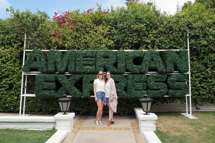 "Erin Maxwell stands with direct boss Amy Marino at the Platinum House at Parker Palm Springs during Coachella 2018. Maxwell and her team helped design the entrance of the Platinum House. ""The process starts in December 2017, so it is approximately four and a half months of planning. My team works on all aspects of the Platinum House including the partner and activation elements; creation of the physical structure; negotiate contracts with music artists; create and deploy marketing and social media and assist our public relation partners on press outreach,"" Maxwell said. ""The Platinum House provides American Express Card Members access to an oasis away from the festival grounds to enjoy the Palm Springs weather before heading to Coachella for the evening acts."""