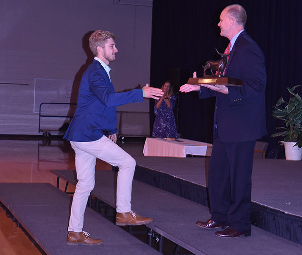 """Accepting the 2018 Founder's Award from Principal JeremyMitchell, seniorDaniel Loaney reflects on his experiences at West. The Founder's Award is given to the student who best exemplifies what West students stand for: good character, academics, school spirit and is the highest school honor. """"I was overwhelmed, it was a surreal moment to look out and see four years of my life had gone by. I've loved this place, and being here,"""