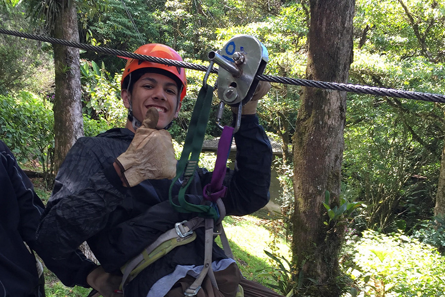 "Sophomore Hasan Rizvi poses before ziplining. ""It was a lot of fun hanging out with my friends outside of the country and seeing my teachers outside the classroom,"" Rizvi said."