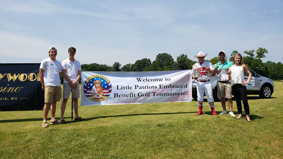 """Juniors Nolan Barbre and Landon Dupont stand with volunteers at the Little Patriots Embraced (LPE) Golf Shootout. """"Volunteering at events is an easy way for members of the community to get involved,"""" Dupont said."""