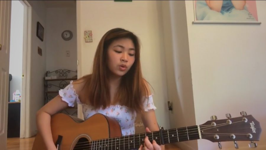 """Debuting her song """"You and Me,"""" junior Charlize Chiu plays the guitar for her first live recording on Youtube. Chiu spent almost three months working on additional verses and instrumental parts. """"The most challenging aspect of running social media accounts is finding ways to stay motivated and please everyone on each platform, including myself,"""" Chiu said. """"Sometimes people don't like the same things as I do, and that makes things hard."""""""