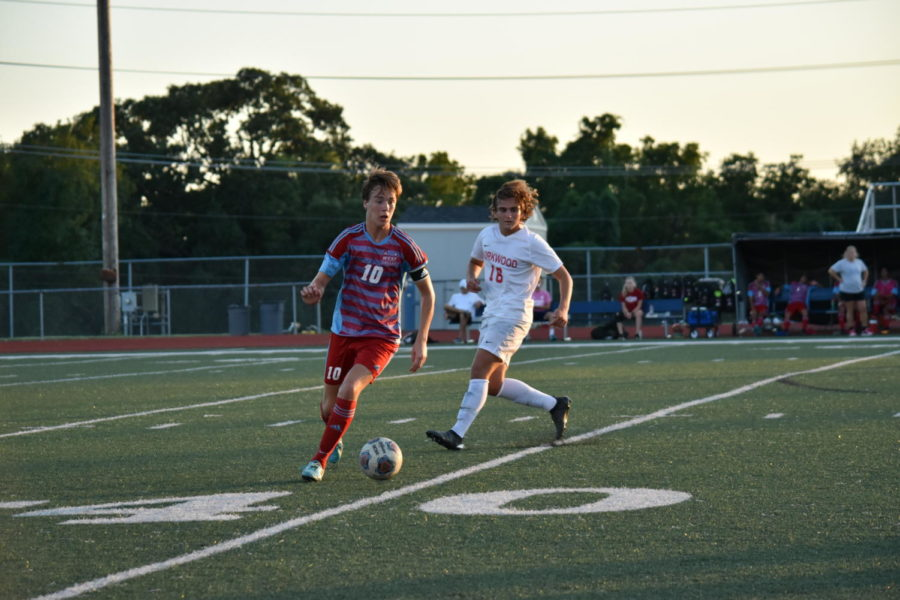 """Cutting away from a Kirkwood player, senior and varsity defender Dylan Zurweller dribbles the ball down the field. The team went into overtime against Kirkwood Aug. 28 and ended the game with a score of 1-0. """"We're actually pretty used to [going into overtime]. Last year we went into overtime a lot, so we have a lot more experience with that, and we were pretty comfortable,"""" Zurweller said. """"We used to not score at all, but throughout this season [our goal is] to start scoring a lot more."""""""