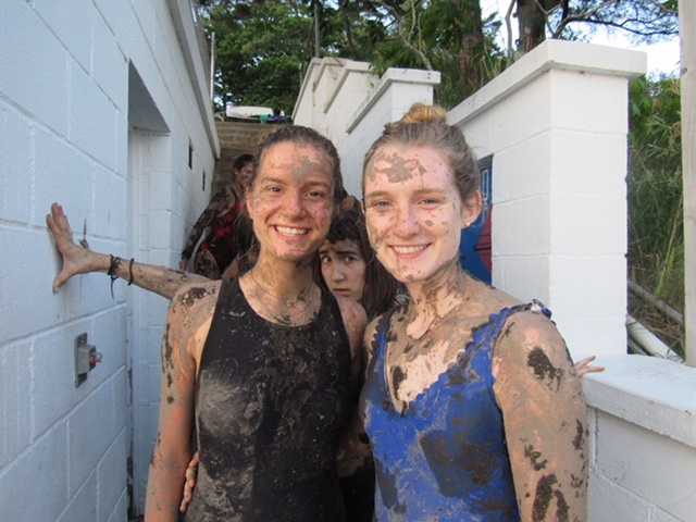 "Covered head to toe in mud, senior Harper Stewart poses with a cabin mate after venturing out to a nearby swamp. Along with spontaneous mud wars, campers went wakeboarding, jet skiing and practiced their archery skills. ""One of my favorite memories would be having a mud war. It looked like a scene straight out of 'Shrek,'"" Stewart said. ""I had algae and mud stuck in my ears for the next week."""