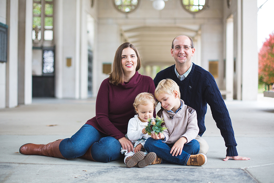 "James Bosanquet sits with his wife Jill, his son Grant and his daughter Clara at the Muny entrance for a family picture. Grant and Clara are both future longhorns and Jill currently a family physician practicing weight loss medicine. ""As a critical care physician, we work some long, yet predictable hours. I could not ask for a more supportive family,"