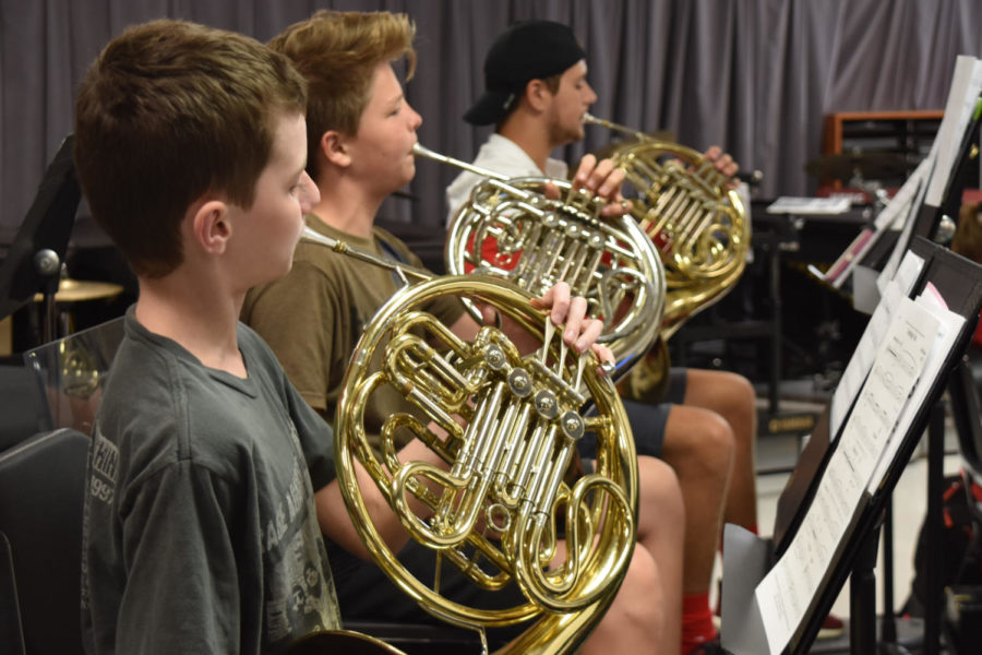 "Freshman Caleb Upchurch plays the french horn in concert band. ""I think band has been fun so far, and the level of music is about average,"" Upchurch said. Currently in the process of selecting what to play in their October concert, the students are playing a wide variety of pieces from Robert Sheldon to Caesar Giovannini."