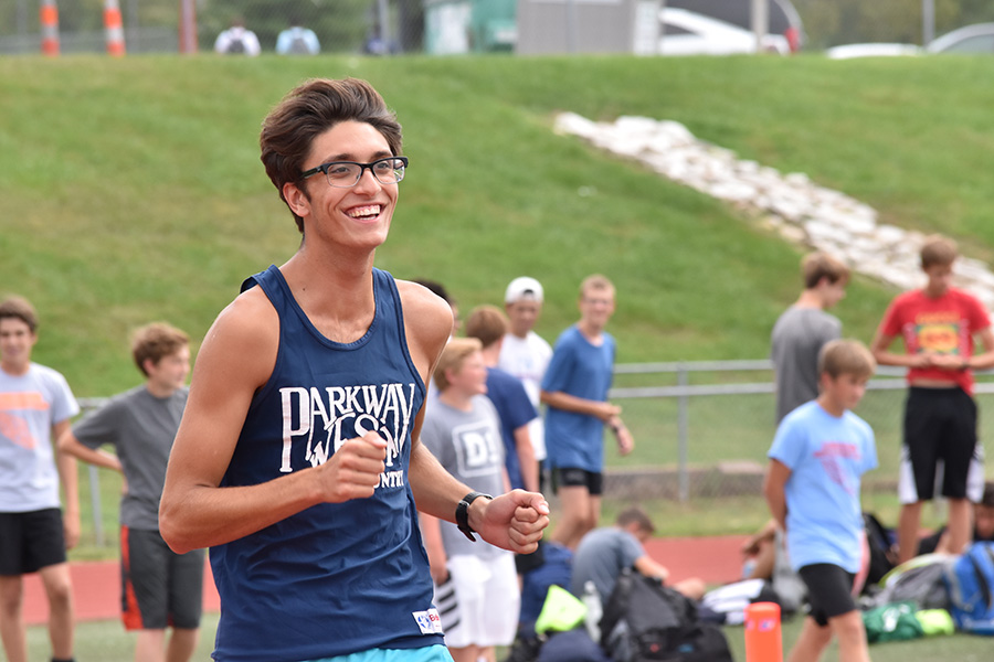 "Senior Caleb Canatoy leads the pack during a boys Cross Country practice. Despite having his lung collapse last spring, Canatoy is a captain on the Varsity team and hopes to inspire young runners in the same way alumnus Jacob Cupps did for him. ""My freshman year we had Jacob Cupps as a captain and he was also going through an injury, but it was cool how he had a connection to the freshmen,"" Canatoy said."