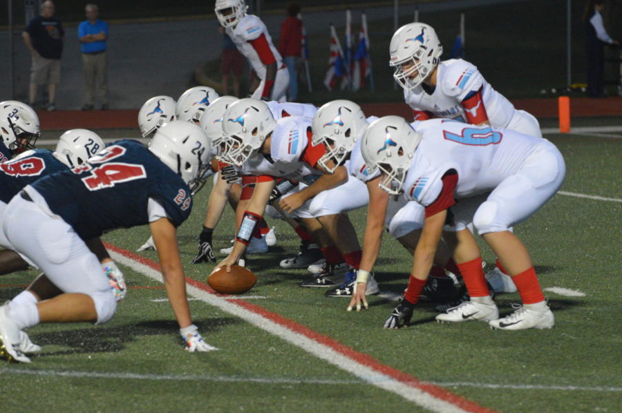 Taking the snap, senior quarterback Collin Krewson prepares to run the play. Parkway West defeated Parkway South 35-0 in the first game of the season.