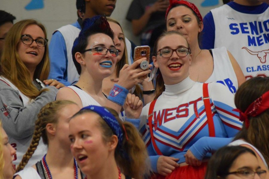 Students laugh in the bleachers at last year's homecoming pep rally.