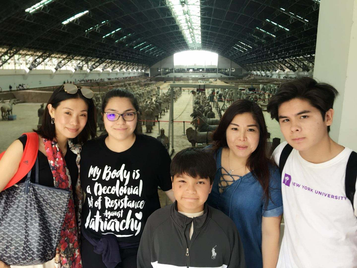 "Standing with a family friend, mother Xiao Gray, brother Christopher Gray, freshman Victoria Gray and sophomore Andrew Gray visit the terracotta warriors in Xi'an China. The Gray family visited the museum after the children finished camp. ""By the end [the museum]  got jam packed with people, tourists, students and guides, but luckily we got there early. It was really interesting to see all the statues in real life,"" Victoria said."